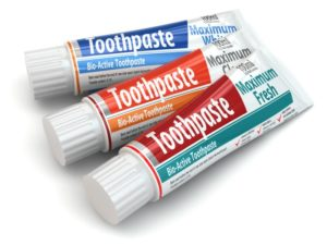 assorted tubes of toothpastes
