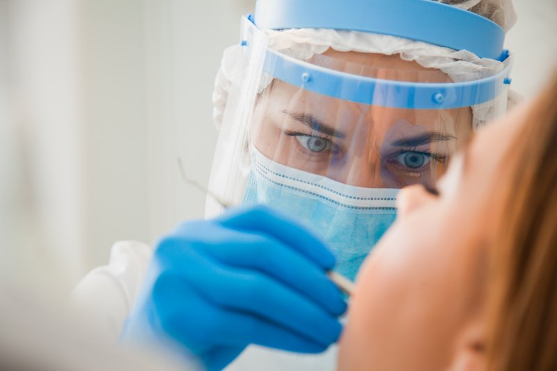 Dentist wearing PPE during procedure
